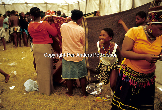NONGOMA, SOUTH AFRICA - SEPTEMBER 11: An unidentified girl comes out smiling after being tested for her virginity during the annual Reed Dance on September 11, 2004 in Nongoma in rural Natal, South Africa. About 20.000 maidens from all over South Africa arrived to dance for Zulu King Goodwill Zwelethini at the Enyokeni Royal Palace in Kwa-Nongoma about 350 kilometers from Durban. The girls come to the kingdom to declare their virginity and the ceremony encourages girls and young women to abstain from sexual activity to curb the spread of HIV-Aids..(Photo: Per-Anders Pettersson).....