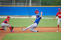 Toronto Blue Jays Andrew Guillotte (1) slides into second as Grenny Cumana (12)  waits for the throw during an instructional league game against the Philadelphia Phillies on September 28, 2015 at the Englebert Complex in Dunedin, Florida.  (Mike Janes/Four Seam Images)