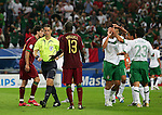 21 June 2006: Miguel (POR) (13) pleads his case with match referee Lubos Michel (SVK) (yellow) after being called for a foul on Luis Perez (MEX) (23), leading to a penalty kick for Mexico. Portugal defeated Mexico 2-1 at Veltins Arena in Gelsenkirchen, Germany in match 31, a Group D first round game, of the 2006 FIFA World Cup.