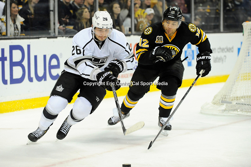January 20, 2014 - Boston, Massachusetts, U.S. - Boston Bruins right wing Jarome Iginla (12) and Los Angeles Kings defenseman Slava Voynov (26) battle for the puck during the NHL game between Los Angeles Kings and the Boston Bruins held at TD Garden in Boston Massachusetts. The Bruins defeated the Kings 3-2 in regulation time.   Eric Canha/CSM