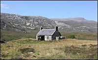 BNPS.co.uk (01202 558833)<br /> Pic: GeoffAllan/BNPS<br /> <br /> Located at Strabeg on the Northern Highlands is a perfect farmhouse retreat.<br /> <br /> Views with rooms. - New book reveals the remote 'bothies' that lie hidden in some of Britain's most spectacular locations.<br /> <br /> Nestled away in the beautiful remote wilderness of Scotland are a network of secluded mountain huts - known as bothies - where walkers can stay the night before heading to pastures new.<br /> <br /> What is so special about these quaint outposts in some of the most idyllic and untouched landscapes north of the border is that they are completely free to use.<br /> <br /> As a result, the location of many bothies has been a closely guarded secret with visitor centres reluctant to advertise their whereabouts for fear they become overcrowded.<br /> <br /> But in his new book, The Scottish Bothy Bible, author and photographer Geoff Allan has listed more than 80 of them in a bid to make them known to a wider audience.