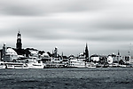 the Hamburg harbor with boats and sailing ships in Hamburg.