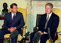 """United States President Bill Clinton, right, and US Vice President Al Gore, left, meet with reporters in the Oval Office of the White House in Washington, DC to discuss the situation in Iraq following the two strikes by US cruise missiles against Iraqi military targets on September 4, 1996.  The President announced the attacks were successful and said that Iraqi leader Saddam Hussein """"knows there is a price to be paid for stepping over the line."""" Photo Credit: Ron Sachs/CNP/AdMedia"""