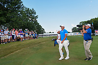 Brooks Koepka (USA) smiles as he departs the green on 18 after winning the WGC FedEx St. Jude Invitational, TPC Southwind, Memphis, Tennessee, USA. 7/28/2019.<br /> Picture Ken Murray / Golffile.ie<br /> <br /> All photo usage must carry mandatory copyright credit (© Golffile | Ken Murray)