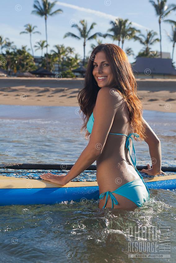 A standup paddler prepares to head out at Ka'anapali Beach, Maui.