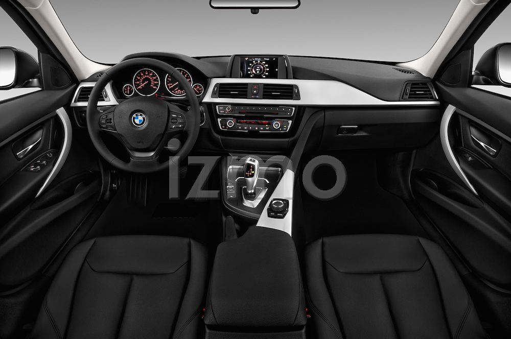 Stock photo of straight dashboard view of 2018 BMW 3-Series 320i 4 Door Sedan Dashboard