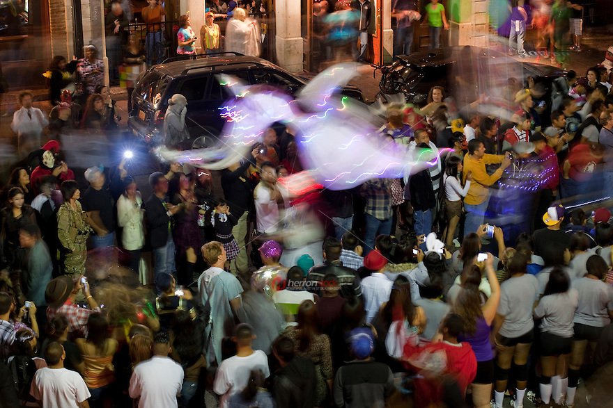 6th Street Halloween features costumed circus members, marching bands, multiple large scale circus animal puppets parading throughout sixth street in Austin, Texas