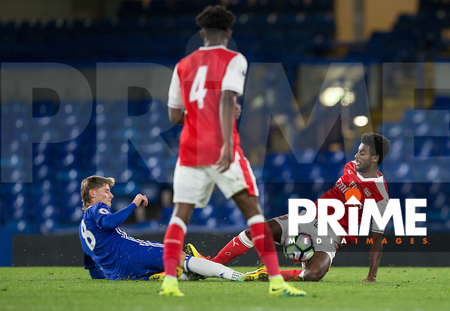 Gedion Zelalem of Arsenal goes in for a tackle that leaves Kyle Scott of Chelsea injured during the EPL2 - U23 - Premier League 2 match between Chelsea and Arsenal at Stamford Bridge, London, England on 23 September 2016. Photo by Andy Rowland.