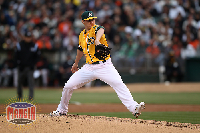 OAKLAND, CA - JUNE 22:  Jarrod Parker #11 of the Oakland Athletics pitches against the San Francisco Giants during the game at O.co Coliseum on Friday June 22, 2012 in Oakland, California. Photo by Brad Mangin