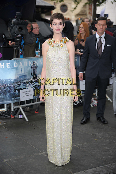 Anne Hathaway (wearing Gucci).'The Dark Knight Rises' European premiere at Odeon Leicester Square cinema, London, England..18th July 2012.full length embellished jewel encrusted flowers floral pearls collar short cropped hair sleeveless silver gold cream beige dress .CAP/CAS.©Bob Cass/Capital Pictures.