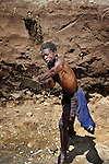"Jackson Thawalima, 45, digs out a reservoir for an irrigation system in Chisatha, a village in southern Malawi on its border with Mozambique. This village has been hard hit by drought in recent years, leading to chronic food insecurity, especially during the ""hunger season,"" when farmers are waiting for the harvest. The ACT Alliance is working with farmers in this village to switch to alternative, drought-resistant crops, such as millet, as well as using irrigation and other improved techniques to increase agricultural yields. Solar panels will power a pump that will draw water from a river into this reservoir and then into six elevated 5,000 liter tanks, which will then provide water to grow crops year round."