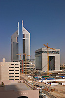 Dubai, United Arab Emirates.  Construction adjacent to Abu Dhabi Road and Emirates Towers in background. .