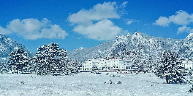 The historic Stanley Hotel, which was built in 1909 by F.O. Stanley, photographed in 1980 nestled in a blue-sky winter landscape in Estes Park, Colorado, USA