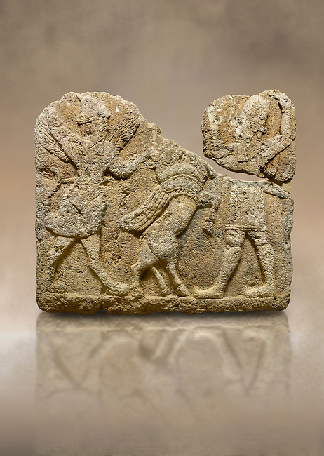 Hittite relief sculpted orthostat stone panel of Herald's Wall. Limestone, Karkamıs, (Kargamıs), Carchemish (Karkemish), 900-700 B.C. Anatolian Civilisations Museum, Ankara, Turkey.<br /> <br /> On the left is a winged mixed creature with a human head and body who has a scorpion tail and bird legs; on the right is a human-like god. The figures fight with a winged bull standing on its hind legs. The scorpion-man is known as Girtablull. <br /> <br /> Against a brown art background.