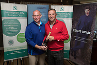 NCBC President Ian Roberts hands over the Nearest the Pin 14th hole prize of Champagne donated by Turner & Townsend to Nigel Jemson of Woodhead