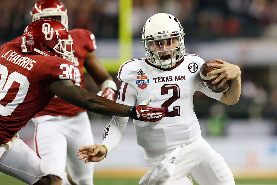 Jan 4, 2013; Arlington, TX, USA; Texas A&M Aggies quarterback Johnny Manziel (2) runs for a touchdown against the Oklahoma Sooners defensive back Javon Harris (30) during the Cotton Bowl at Cowboys Stadium.  Mandatory Credit: Tim Heitman-USA TODAY Sports