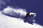 A man telemark skiing in the backcountry near Brighton, UT.