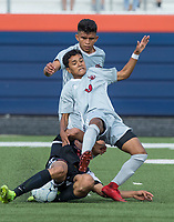 NWA Democrat-Gazette/BEN GOFF @NWABENGOFF<br /> Irvin Sotero (19) and Jose Vega (10) of Springdale and Christian Chavez (12) of Fort Smith Northside collide Saturday, May 12, 2018 during the semifinal match in the boys 7A state soccer tournament in Gates Stadium at Rogers Heritage.