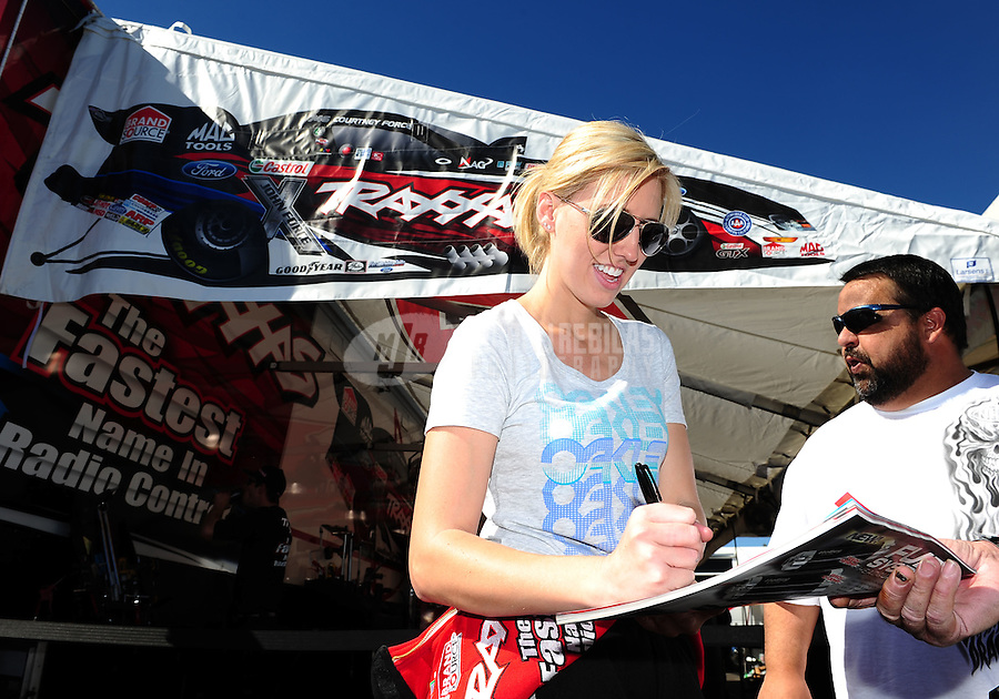 Feb. 9, 2012; Pomona, CA, USA; NHRA funny car driver Courtney Force during qualifying at the Winternationals at Auto Club Raceway at Pomona. Mandatory Credit: Mark J. Rebilas-
