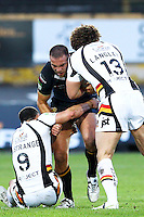 PICTURE BY ALEX WHITEHEAD/SWPIX.COM - Rugby League - Super League - Bradford Bulls vs Hull FC - Odsal Stadium, Bradford, England - 01/09/12 - Hull FC's Andy Lynch is tackled by Bradford's Heath L'Estrange and Jamie Langley.