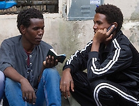 Migranti all'esterno del centro di accoglienza 'Baobab' presso la stazione Tiburtina a Roma, 16 giugno 2015.<br /> Migrants outside of the 'Baobab' refugees center in Rome, 16 June 2015. Italy is facing a huge flow of migrants brought to Sicily after rescue at sea, many of whom are trying to join their relatives in northern Europe. <br /> UPDATE IMAGES PRESS/Riccardo De Luca
