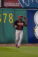 Lansing Lugnuts outfielder Dwight Smith Jr. #18 catches a fly ball during a game against the Cedar Rapids Kernels at Veterans Memorial Stadium on April 29, 2013 in Cedar Rapids, Iowa. (Brace Hemmelgarn/Four Seam Images)