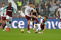 Mark Noble of West Ham tackles Ashley Barnes of Burnley  during West Ham United vs Burnley, Premier League Football at The London Stadium on 10th March 2018