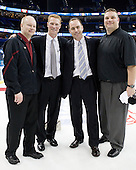 John Hegarty (BC - Dir-Hockey Ops), Greg Brown (BC - Assistant Coach), Mike Cavanaugh (BC - Associate Head Coach), Russ DeRosa (BC - Strength Coach) - The Boston College Eagles celebrate their national championship win in the 2012 Frozen Four on Saturday, April 7, 2012, at the Tampa Bay Times Forum in Tampa, Florida.