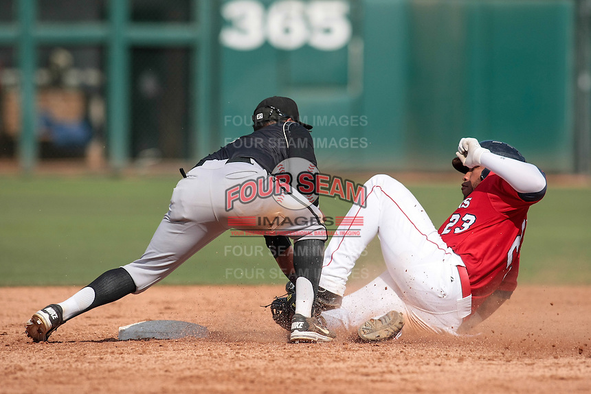 Oklahoma City RedHawks first baseman Jonathan Singleton (23) slides into 2nd and is tagged out by Omaha Storm Chasers second baseman Christian Colon (4) during the Pacific Coast League game at Chickashaw Bricktown Ballpark on June 23, 2013 in Oklahoma City ,Oklahoma.  (William Purnell/Four Seam Images)