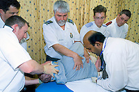 Patient being examined for back injuries. This image may only be used to portray the subject in a positive manner..©shoutpictures.com..john@shoutpictures.com
