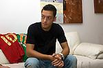 FBL 2009/2010 - Werder Bremen - Interview mit Mesut &Ouml;zil (Oezil) 25.08.2009<br /> <br /> Interview mit Mesut &Ouml;zil (GER Werder Bremen #11) und einer Homestory bei Mesut &Ouml;zil zu Hause.<br /> <br /> Mesut &Ouml;zil (GER Werder Bremen #11) Querformat. Oberk&ouml;rper. Portrait. Links von Ihm seine Trikots der Nationalmannschaft und von Werder Bremen.<br /> <br /> Foto &copy; nph ( nordphoto )
