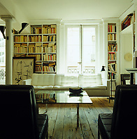 The contemporary Florence Knoll furniture of the library contrasts with the old floorboards and 18th century architecture