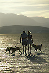 Couple walking with their dogs on the playa in the Black Rock Desert