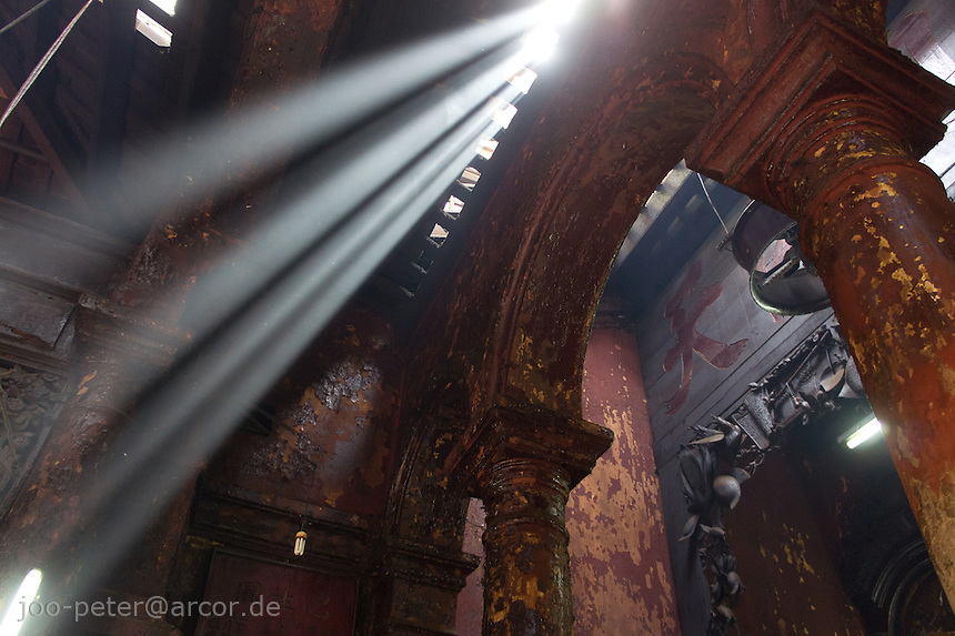 sunbeams in Chua Ngoc Hoang temple in Ho Chi Minh City / Saigon,  Vietnam. Taoist temple Phouc Hai Tu (turtle sanctuary) is called Cua Ngoc Hoang (Jade emperor) by the peope. Vietnamese belief is a blend of Buddhism, Taoism and animism