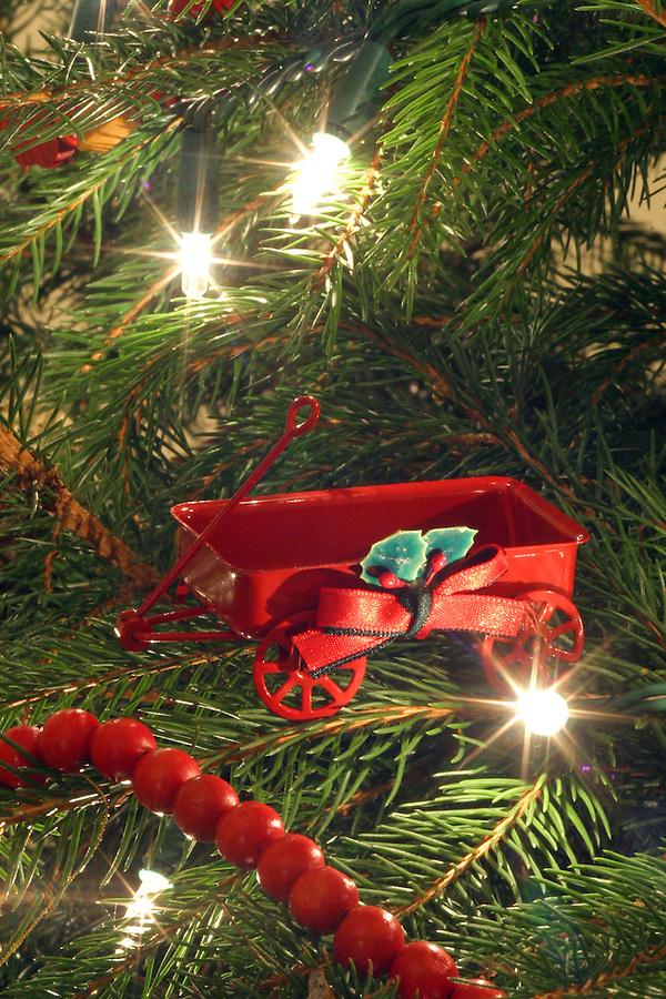 Red wagon ornament on Christmas tree