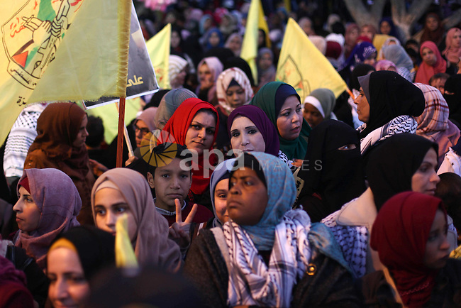 Palestinian supporters of the Fatah movement take part during a rally marking the fifty-fifth anniversary of the creation of the political party, in Gaza city on December 31, 2019. Photo by Mahmoud Ajjour