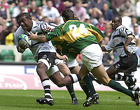 25/05/2002 (Saturday).Sport -Rugby Union - London Sevens.South Africa vs Fiji.Paula Maisiri, breaking with the ball[Mandatory Credit, Peter Spurier/ Intersport Images].