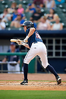 Northwest Arkansas Naturals right fielder Logan Moon (18) squares around to bunt during a game against the Midland RockHounds on May 27, 2017 at Arvest Ballpark in Springdale, Arkansas.  NW Arkansas defeated Midland 3-2.  (Mike Janes/Four Seam Images)