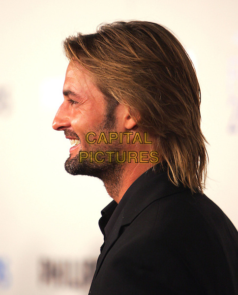 "JOSH HOLLOWAY.The Sony Picture Classics' Premiere of ""William Shakespeare's The Merchant of Venice"" which was part of the AFI Fest 2004 held at The Cinerama Dome in Hollywood, California .November 9th, 2004.headshot, portrait, stubble, facial hair, profile.www.capitalpictures.com.sales@capitalpictures.com.©Debbie Van Story/Capital Pictures"