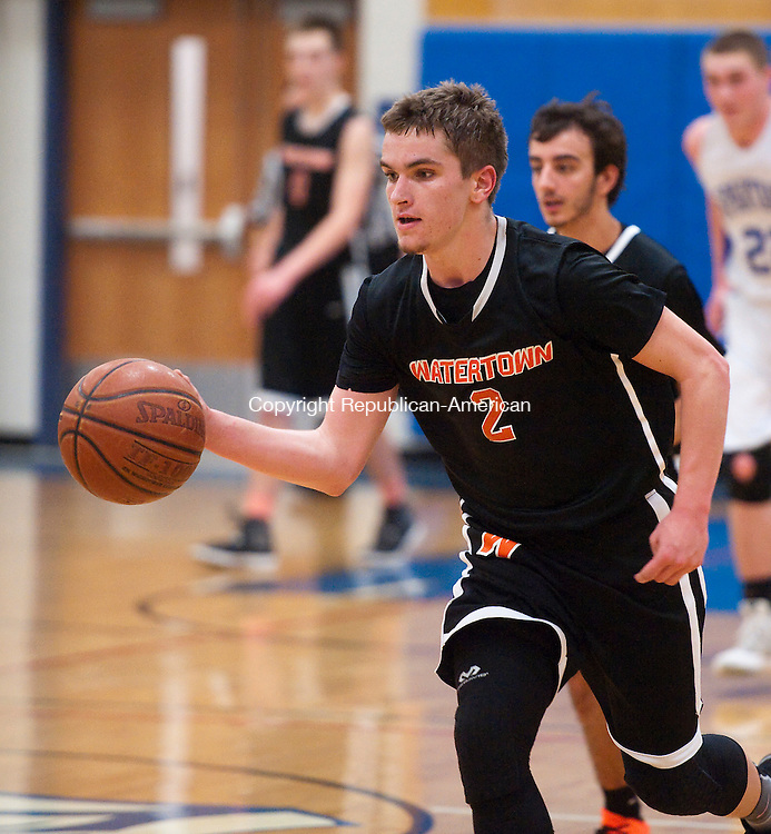 BURLINGTON, CT--- -030816JS15- Watertown's Patrick Barber (2) runs the ball up court during their Class M first round game against Lewis Mills Tuesday at Lewis S. Mills High School in Burlington. <br /> Jim Shannon Republican-American