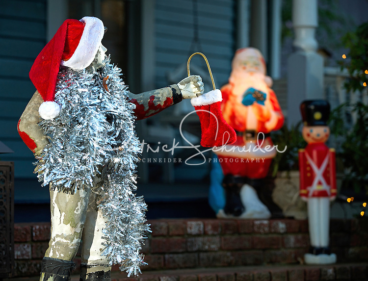 A statue is all decked out in Christmas style at the annual Fourth Ward Holiday Home Tour in Uptown Charlotte, North Carolina. This walkable, self-guided tour allows visitors to get into the Christmas holiday spirit while checking out the beautifully decorated home in Charlotte's historic Fourth Ward.  <br /> <br /> Charlotte Photographer - PatrickSchneiderPhoto.com
