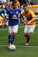 Tim Cahill closed down by Simon Ramsden in the Motherwell v Everton friendly match at Fir Park, Motherwell on 21.7.12 for Steven Hammell's Testimonial.