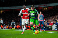 ( L-R )Joel Campbell of Arsenal  and Stephen Kingsley of Swansea City  in action during the Barclays Premier League match between Arsenal and Swansea City at the Emirates Stadium, London, UK, Wednesday 02 March 2016