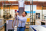 Research and Development Technician Jose Garcia holds pressure gauges in the Ice Energy test bay where the company is running tests on Ice Cubs (smaller Ice Bears) at Ice Energy in Glendale, California, December 17, 2014. The company's Ice Bear uses frozen water to replace the cooling power of large air conditioning units.