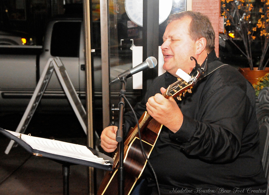 Musician Dennis Harris entertains guests at Dawn's Delectables during Centralia, Washington's Third Thursday on October 20, 2016.