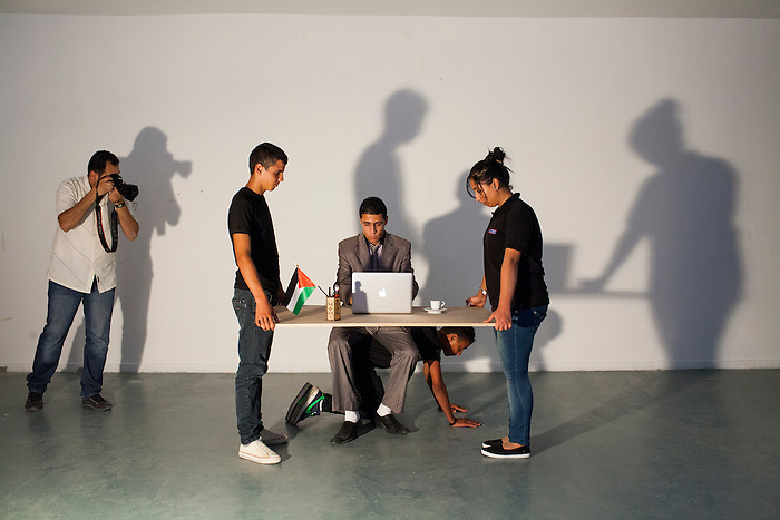 June 2013, Ramallah, West Bank. Osama, a young contemporary artist graduated from the Art academy of Ramallah, is carrying out a performance. He presents his work as a critic of capitalism in general.