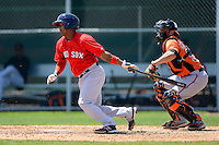 Boston Red Sox catcher Alberto Rosario #16 at bat in front of catcher Luis Exposito during a minor league Spring Training game against the Baltimore Orioles at Buck O'Neil Complex on March 25, 2013 in Sarasota, Florida.  (Mike Janes/Four Seam Images)