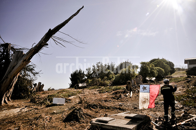 Chile, Aftermath of the tsunami in the area of Consitucion. Fireman looking for dead body in the ruins of Pelluhue 65 km south from Consitucion.