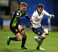 Bolton Wanderers' Andrew Taylor battles with Bury's Taylor Moore<br /> <br /> Photographer Alex Dodd/CameraSport<br /> <br /> The EFL Sky Bet League One - Bolton Wanderers v Bury - Tuesday 18th April 2017 - Macron Stadium - Bolton<br /> <br /> World Copyright &copy; 2017 CameraSport. All rights reserved. 43 Linden Ave. Countesthorpe. Leicester. England. LE8 5PG - Tel: +44 (0) 116 277 4147 - admin@camerasport.com - www.camerasport.com
