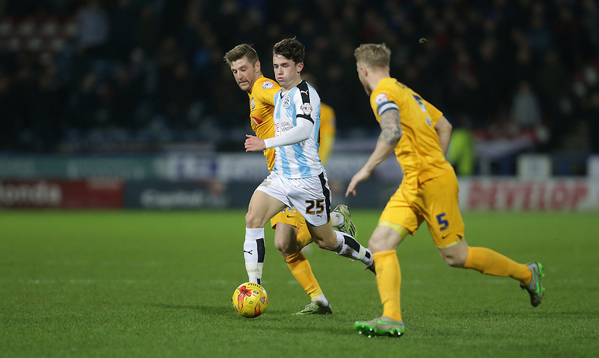 Huddersfield Town's Ben Chilwell battles with Preston North End's Paul Gallagher (left) and Tom Clarke<br /> <br /> Photographer Stephen White/CameraSport<br /> <br /> Football - The Football League Sky Bet Championship - Huddersfield Town v Preston North End - Saturday 26th December 2015 - The John Smith's Stadium - Huddersfield<br /> <br /> &copy; CameraSport - 43 Linden Ave. Countesthorpe. Leicester. England. LE8 5PG - Tel: +44 (0) 116 277 4147 - admin@camerasport.com - www.camerasport.com